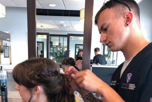 Shore cosmetology student working on client