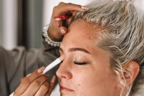 Shore skin care graduate working on client